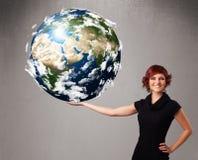 Ragazza graziosa che tiene la terra del pianeta 3d Fotografia Stock