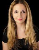 Ragazza graziosa con capelli biondi lunghi Fotografie Stock