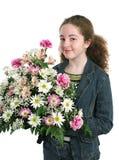 Ragazza graziosa con i fiori immagini stock