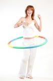 Ragazza graziosa con il cerchio di hula Fotografie Stock