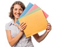 Ragazza graziosa con molti dispositivi di piegatura di carta Immagini Stock Libere da Diritti
