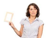 Ragazza graziosa con un blocco per grafici della foto Fotografie Stock