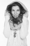Ragazza graziosa in un maglione bianco Fotografia Stock
