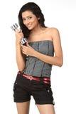 Ragazza indiana con i segnalatori acustici muti Fotografie Stock