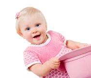 Ragazza infantile sorridente isolata su bianco Fotografia Stock