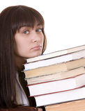 Ragazza intelligente con il libro del mucchio. Immagine Stock