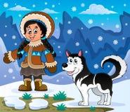 Ragazza inuit con il cane del husky Immagini Stock
