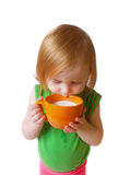 Ragazza isolata con latte su priorità bassa bianca Immagine Stock Libera da Diritti