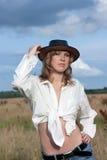 Ragazza in jeans e cappello Immagine Stock