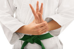 Ragazza in kimono che torce il suo braccio Fotografie Stock