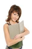 Ragazza l'adolescente con i sorrisi del libro immagini stock