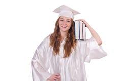 Ragazza laureata con i libri Fotografie Stock