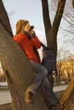 Ragazza, macchina fotografica, tramonto Fotografia Stock