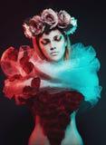 Ragazza magica con le rose Fotografia Stock
