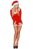 Ragazza in maglione, cappello, ragazza dello scYoung in breve vestita come sorridere di Santa Claus Fotografia Stock Libera da Diritti