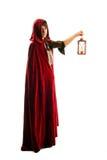 Ragazza in mantello rosso con una candela - lanterna Immagini Stock