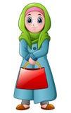 Ragazza musulmana felice che tiene borsa rossa illustrazione vettoriale
