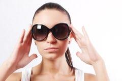 Ragazza negli occhiali da sole Immagine Stock