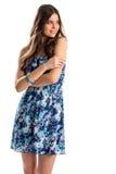 Ragazza nei sorrisi blu del vestito Fotografia Stock