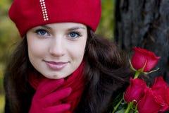 Ragazza nel colore rosso Fotografie Stock