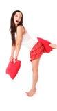 Ragazza nel colore rosso con il cuscino Fotografia Stock Libera da Diritti