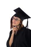 Ragazza nel manto dello studente che guarda vago Fotografie Stock Libere da Diritti