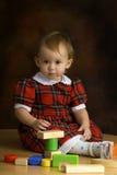 Ragazza nel vestito scozzese Fotografia Stock