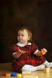 Ragazza nel vestito scozzese Immagine Stock Libera da Diritti