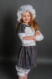 Ragazza nell'annata rustica del vestito su un fondo grigio Fotografia Stock Libera da Diritti