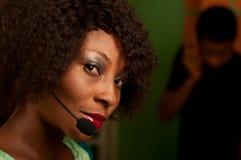 Ragazza nella call center Immagine Stock