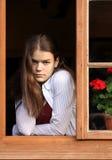 Ragazza nella finestra Fotografia Stock Libera da Diritti