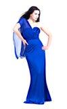 Ragazza nella posizione blu del vestito Immagine Stock