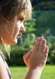 Ragazza nella preghiera Immagini Stock Libere da Diritti