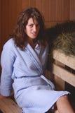 Ragazza nella sauna Immagini Stock