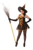 Ragazza nella strega di Halloween con la scopa Fotografia Stock Libera da Diritti