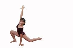 Ragazza nelle pose di ginnastica Immagine Stock Libera da Diritti