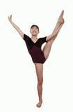 Ragazza nelle pose di ginnastica Fotografia Stock