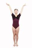 Ragazza nelle pose di ginnastica immagini stock libere da diritti
