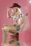 Ragazza piacevole in cappello del cowboy Fotografia Stock