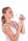 Ragazza piacevole che tiene una bottiglia di acqua Immagine Stock Libera da Diritti
