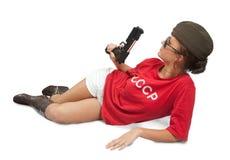 Ragazza in pistola della holding della protezione d'oltremare. Immagine Stock Libera da Diritti