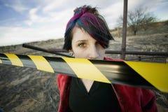 Ragazza punk dietro il nastro di avvertenza Fotografia Stock Libera da Diritti