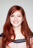 Ragazza redheaded sorridente immagine stock