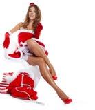 Ragazza sexy che porta i vestiti del Babbo Natale Fotografia Stock Libera da Diritti