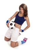 Ragazza sexy con pallone da calcio Fotografie Stock Libere da Diritti