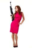 Ragazza sexy di azione con la pistola Immagini Stock Libere da Diritti