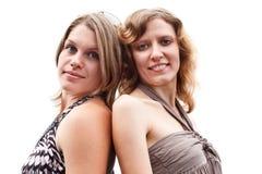 Ragazza sexy due che si leva in piedi di nuovo alla parte posteriore Immagini Stock