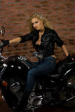 Ragazza sexy sulla motocicletta Fotografia Stock