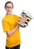 Ragazza sorpresa dello studente che tiene una pila di libri Immagine Stock Libera da Diritti