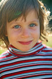 Ragazza sorridente al sole Fotografie Stock
